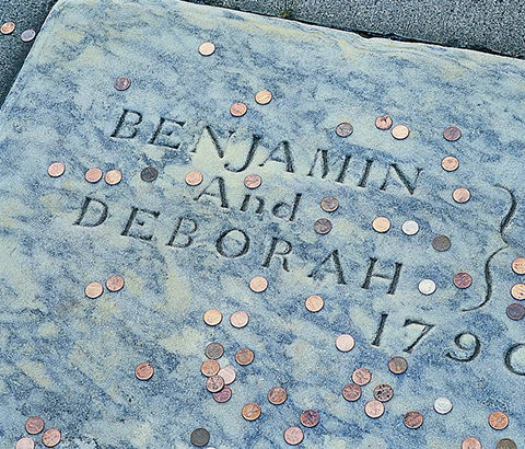 Pennies tossed on Ben Franklin's tombstone
